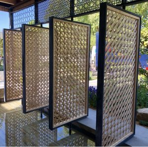Close up of intricate panel screens at the Lemon Tree Trust garden, 2018 RHS Chelsea Flower Show
