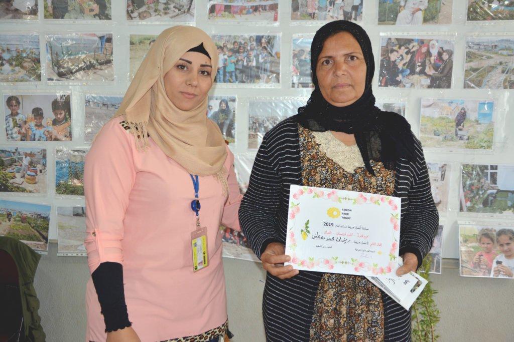 2019 Lemon Tree Trust garden competitions - Kabartu 1 camp - 2nd place prize winner - Rezan Mohammad Mustafa (right) with Lemon Tree Trust's Aveen Ibrahem (left)