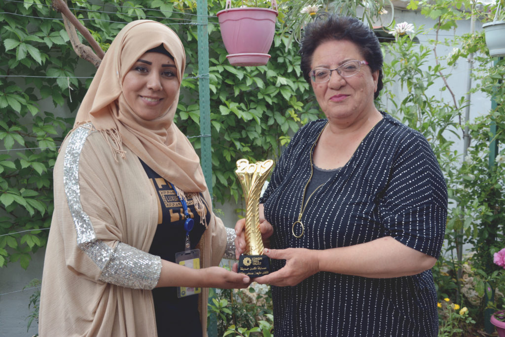 Aveen Ibrahem, Lemon Tree Trust Community Outreach Manager, pictured with Subhi Batal, winner in Domiz 2 camp and overall garden competition winner 2019.