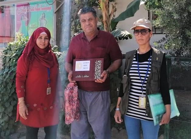 Garden of the Month winner Felroz (centre) with Lemon Tree Trust staff, Rizgari neighborhood of Domiz camp, Kurdistan Region of Iraq