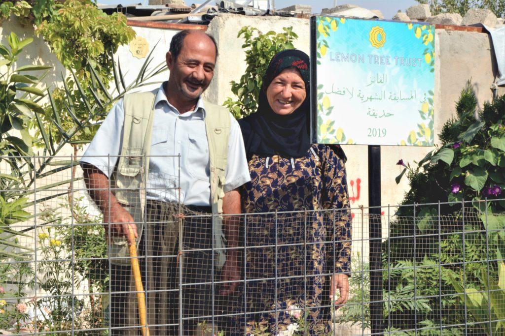 October 2019 Garden of the Month winners Muhammed Hssen and Zainab Abdullah standing in their home garden, Ashti neighbourhood, Domiz 1 camp, Kurdistan Region of Iraq
