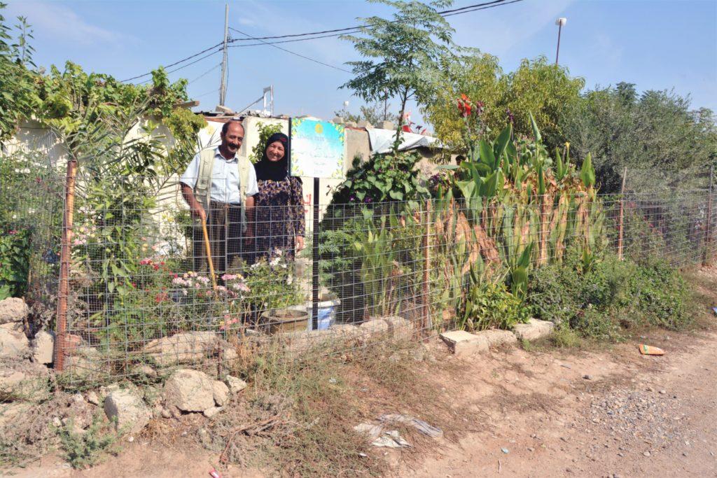 Muhammed Hssen and Zainab Abdullah standing in their garden