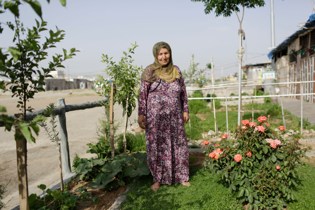 Female gardener standing in her home garden, Kurdistan Region of Iraq