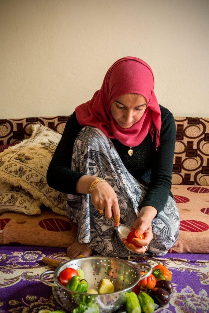 Nosheen preparing vegetables for her Kousa Mahshi recipe
