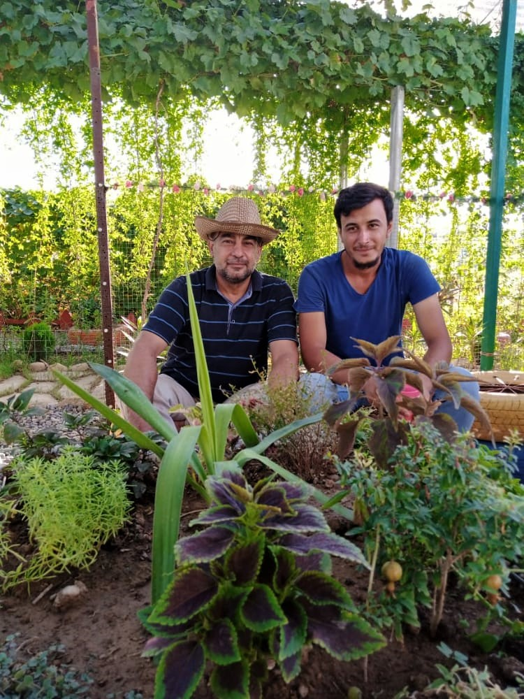 Shalal and Ismail sitting in the Azadi Community Garden, Domiz 1 camp, Kurdistan