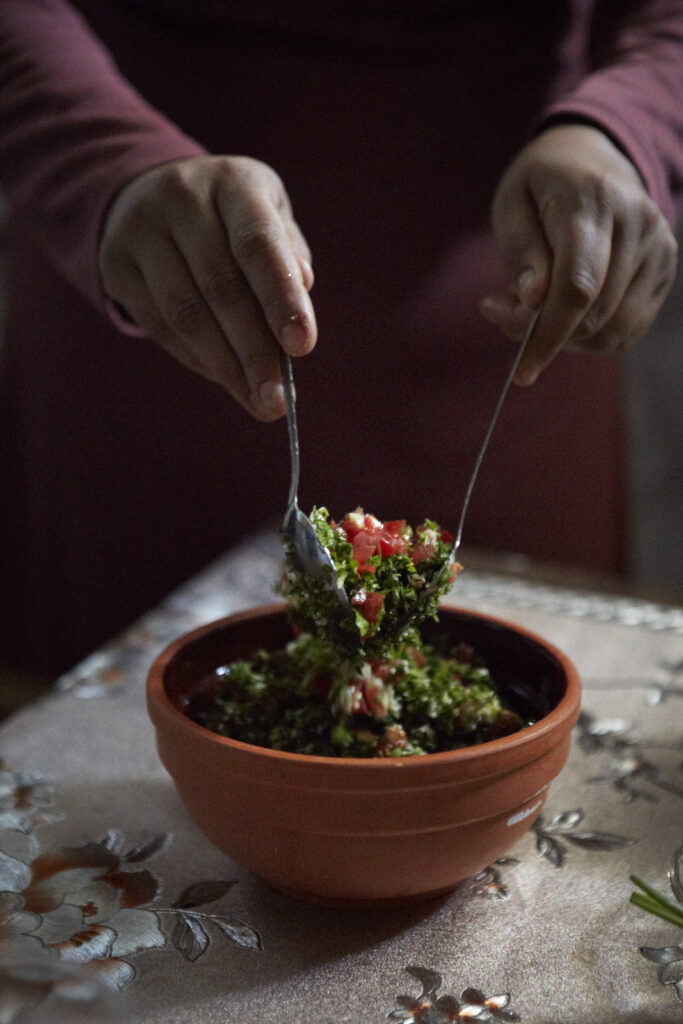 Noora mixing ingredients for tabbouleh
