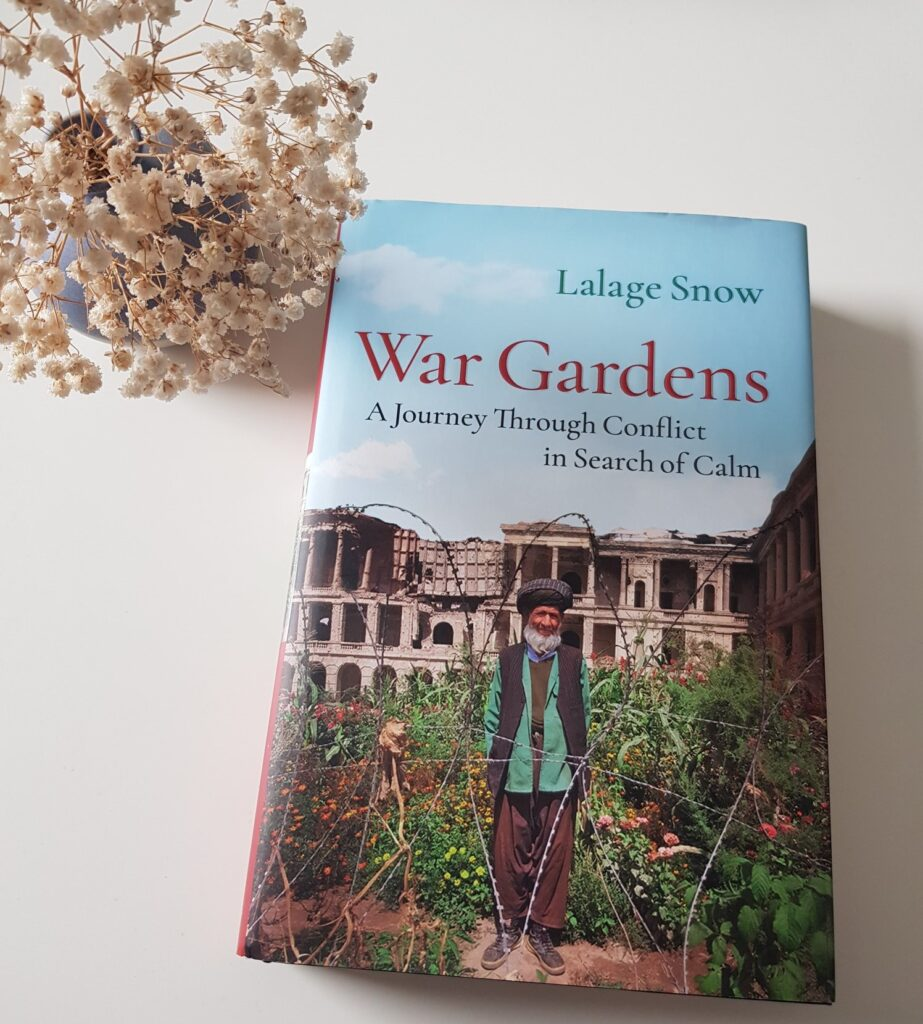War Gardens book with small vase of dried gypsophila