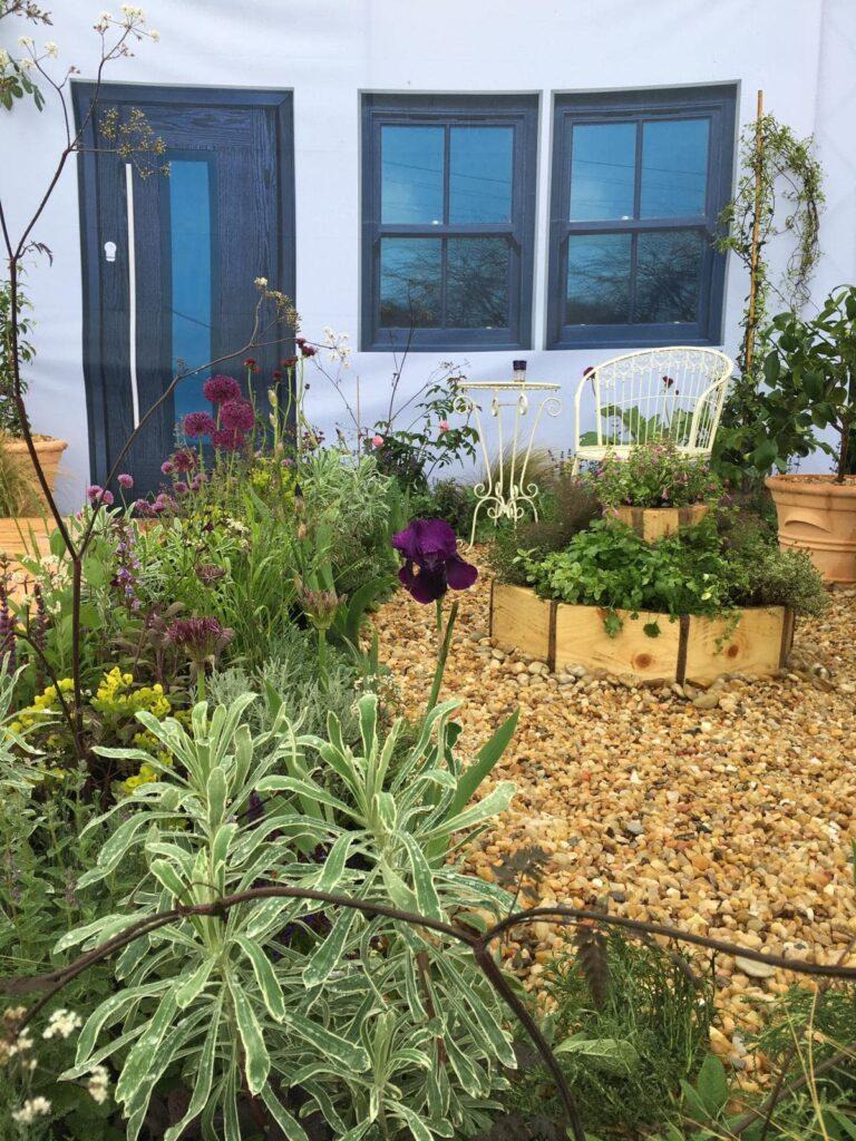John Thoumire's garden 'Bayet' at Gardening Scotland - close up of flowers outside shelter