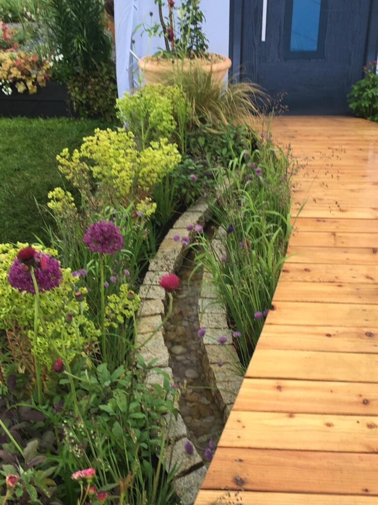John Thoumire's garden 'Bayet' at Gardening Scotland - curved pathway