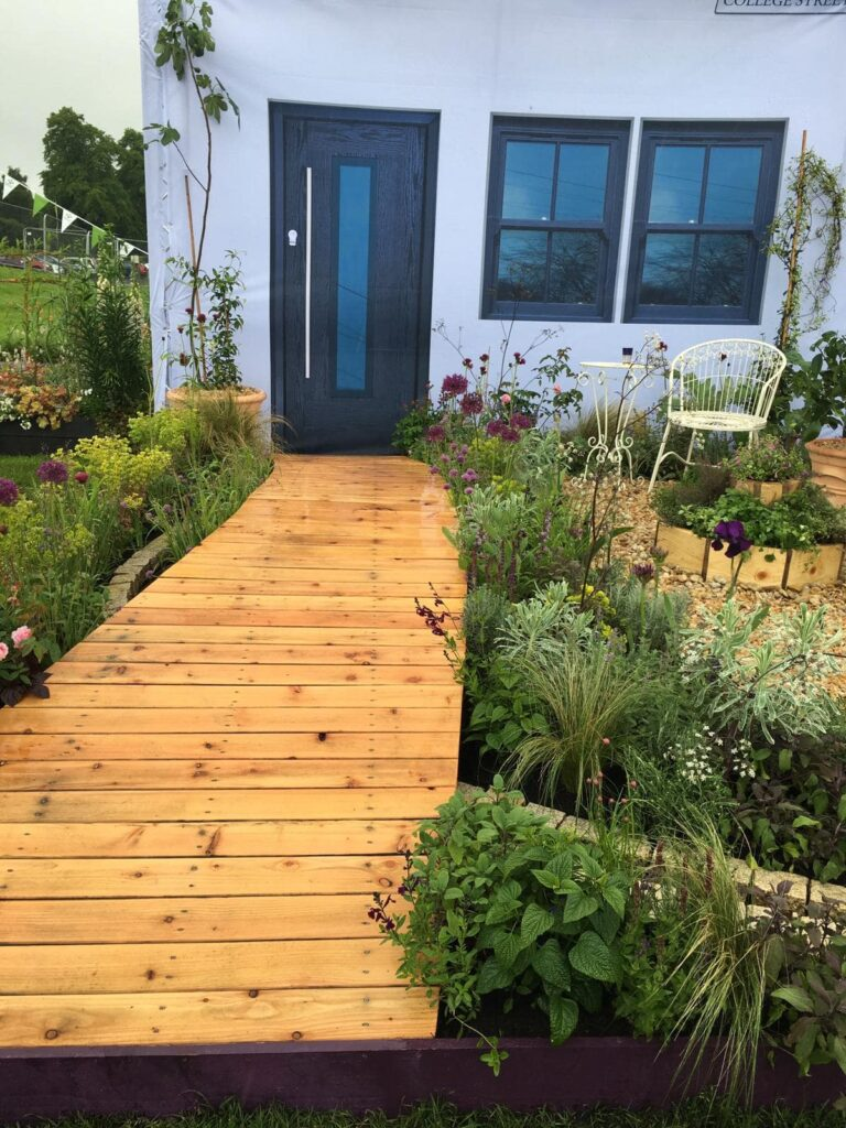 John Thoumire's garden 'Bayet' at Gardening Scotland - view of the pathway to the front door with garden either side